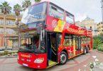 Der rote City Sightseeing Doppeldeckerbus